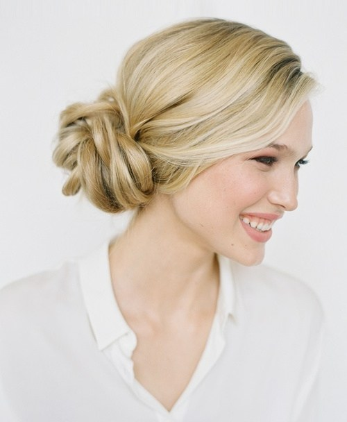 Side-Swept Low Bun with Messy Waves and Bang