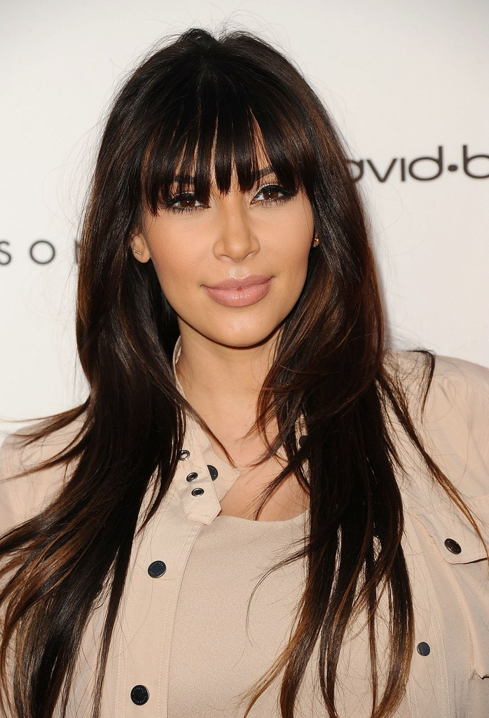 Kim Kardashian's Brunette Hair with Full Bangs