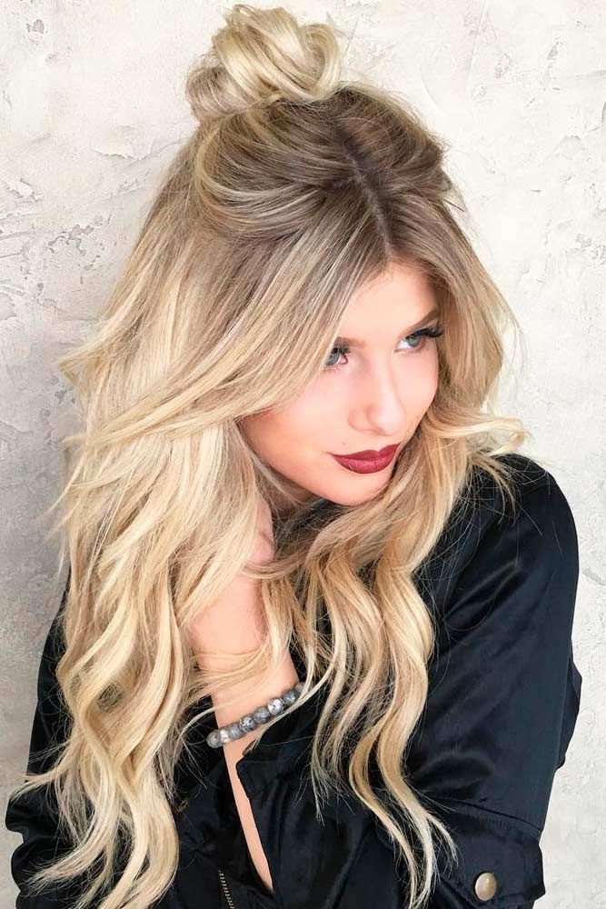 Center Parted Blonde Wavy Hair with Bun