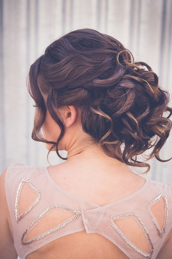 Curly Voluminous Low Bun Updo