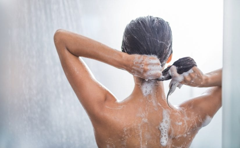Woman using shampoo during taking shower