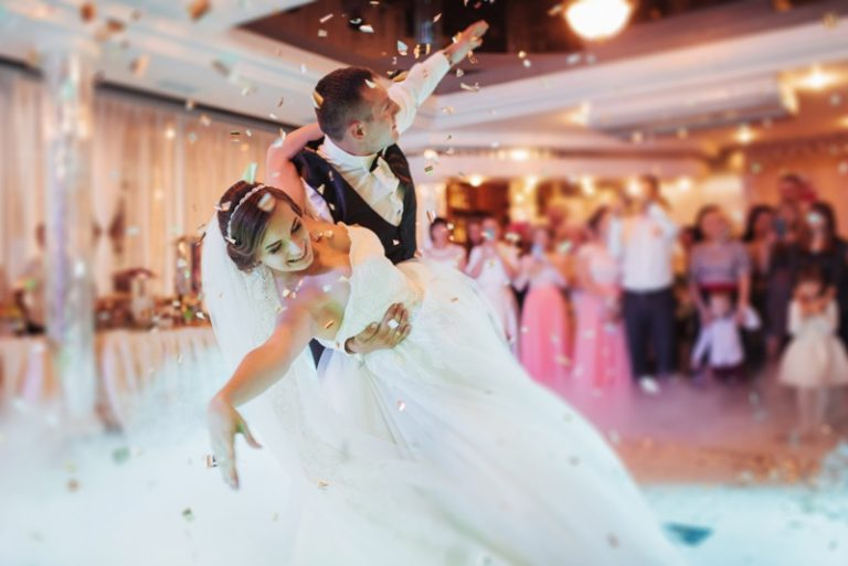 Happy bride and groom their first dance